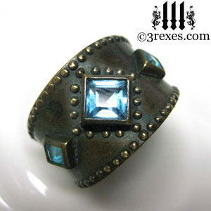 brass-3-wishes-ring-front-blue-topaz-stone-medieval-gothic-wedding-jewelry.jpg
