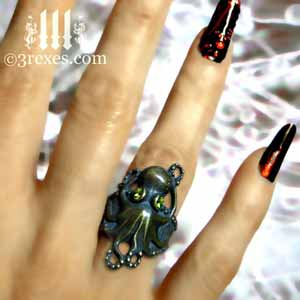 brass octopus dream ring with green peridot stone eyes steampunk studded gothic band model ice background