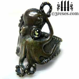octopus-ring-dark-brass-green-peridot-cabochon-eyes-gothic-band
