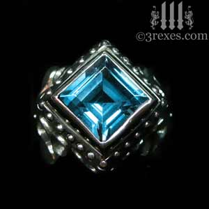 womans gothic rings silver raven-love-ring-blue-topaz-stone-on-black