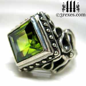 raven-love-silver-wedding-ring-gothic-green-peridot-stone-medieval-engagement-band-side-view august birthstone rings by 3 rexes jewelry