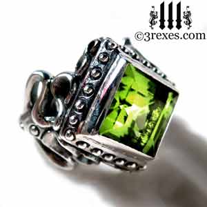 raven-love-silver-wedding-ring-gothic-green-peridot-stone-medieval-engagement-band August birthstone rings by 3 rexes jewelry