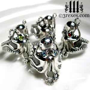 silver-octopus-dream-rings-green-blue-red-black-cabochon-stone-eyes-studded-band by 3 rexes jewelry