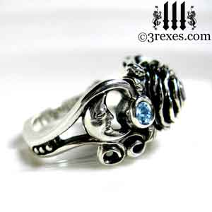 sterling silver moon ring, silver rose ring, silver flower ring, side view with moon detail and blue topaz stones december birthstone by 3 rexes jewelry